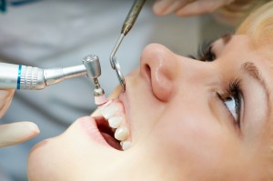 bigstock-close-up-medical-dentist-proce-32297684